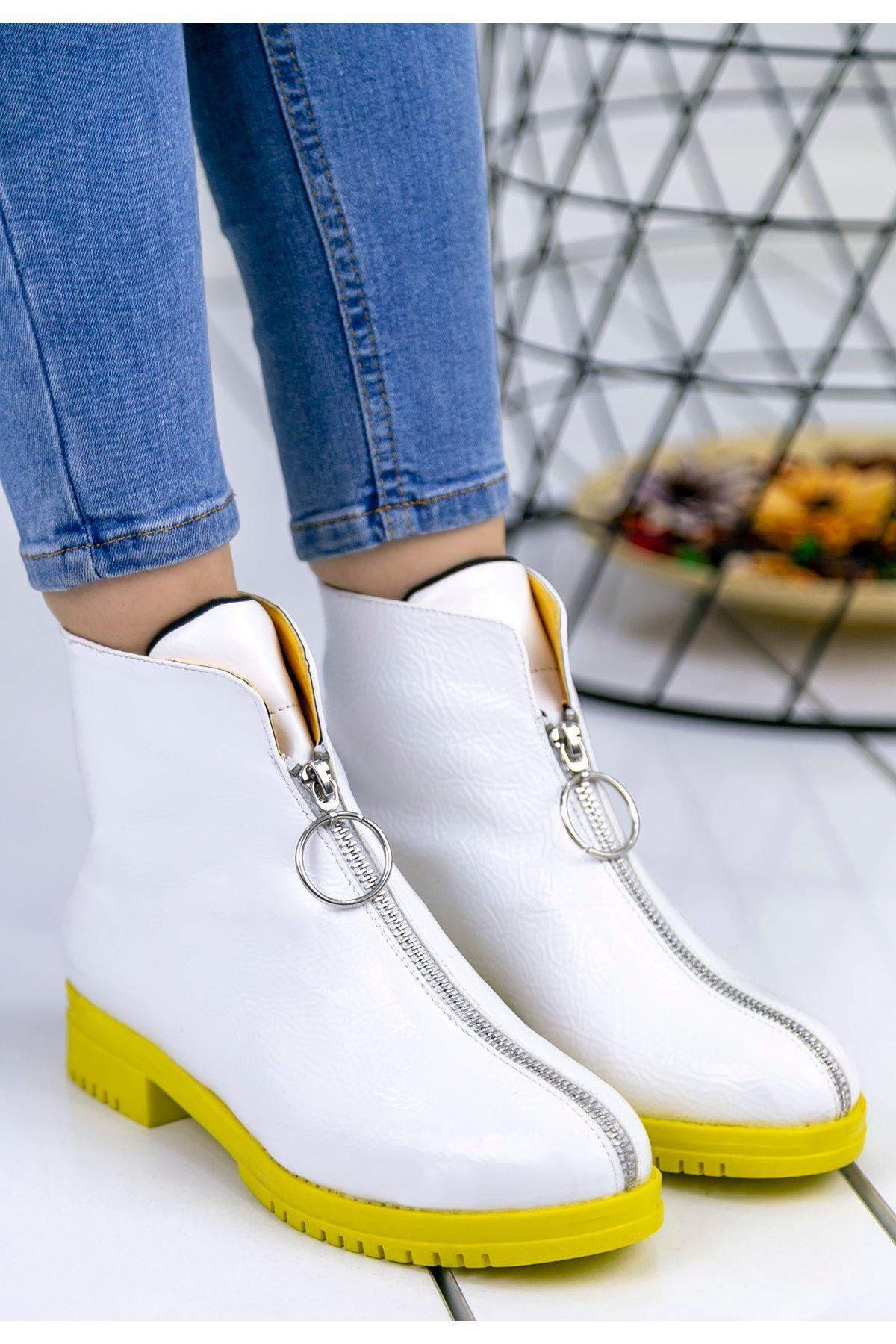 Lili Beyaz Cilt Sarı Tabanlı Bot